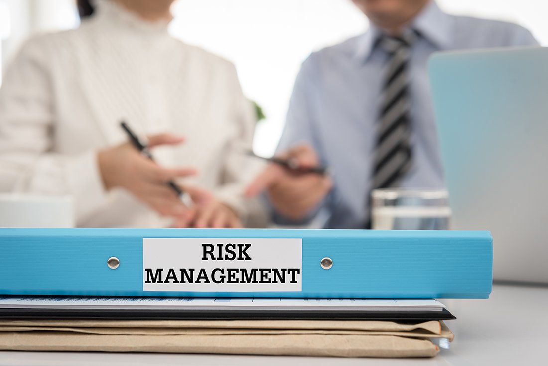 Risk management document file put on the table in the conference room. Risk Management Control Analysis Protection Concept.